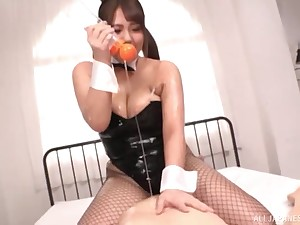 Busty Japanese Housaki Yua oils up her huge tits for a tit job