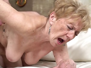 A nasty old granny is getting fucked in her pussy doggy parade