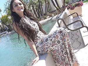 Brunette Natalie starts striping outdoors and ends up masturbating