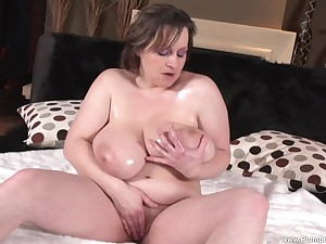 BBW Traci D. shows off the brush big boobs and plays with the brush pussy