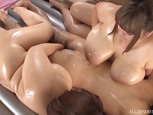 Oiled up Japanese BBW Nanao Madoka and her chubby friend tease one guy