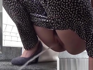Naughty Japanese cuties pissing fro the streets