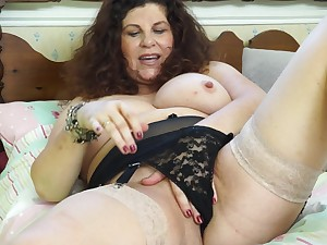 Amateur brunette of age granny Gilly strips at home