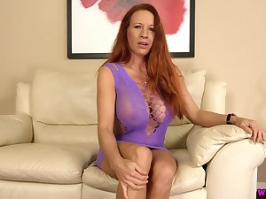 Ample breasted matured red head Faye Rampton is toying her insatiable snatch